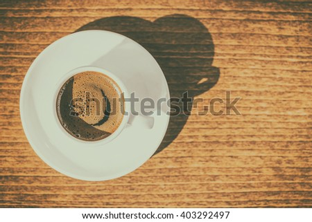 top view morning creativity concept of smiled cup coffee with sunbeams, instagram style or toned effect, close up - stock photo