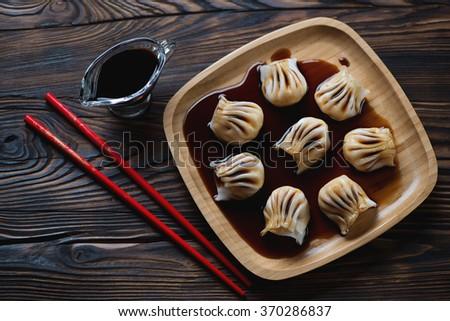 Top view of a bamboo tray with dim-sum dumplings, studio shot - stock photo