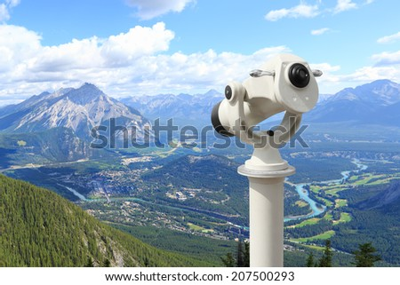 Top view of a Bow river valley and golf courses against Rocky Mountains with telescope. Banff National Park. Alberta. Canada  - stock photo