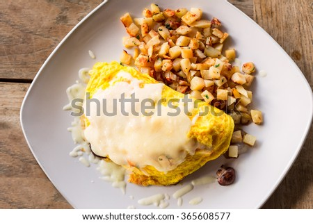 Top view of a breakfast plate with omelet and potatoes - stock photo