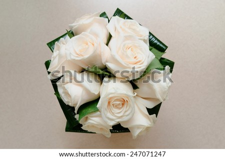 Top view of a bride bouquet made with white roses - stock photo