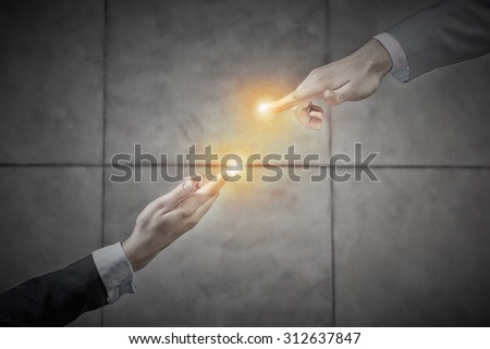 Top view of a businessman and woman shaking hands in office lobby - stock photo