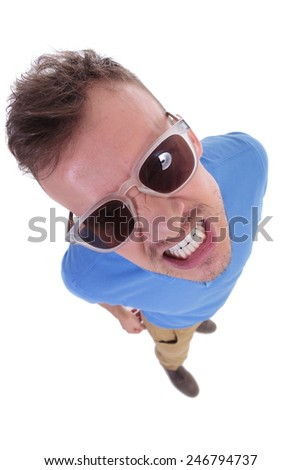 top view of a casual young man showing his teeth to the camera with an angry expression. on a white background - stock photo