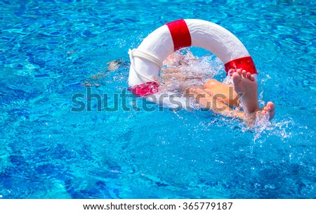 Top view of a girl in the pool - stock photo