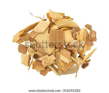 Top view of a group of apple wood chips for flavoring barbecue and grilled foods isolated on a white background. - stock photo