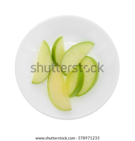 Top view of a group of green apple slices on a plate isolated on a white background. - stock photo