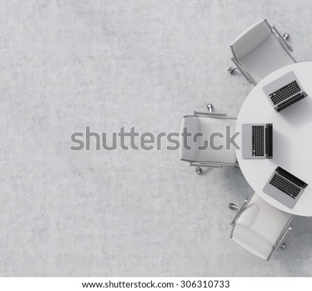 Top view of a half of the conference room. A white round table, three white leather chairs. Three laptops are on the table. Office interior. 3D rendering. - stock photo