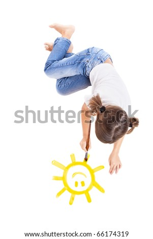 Top view of a happy girl lying on floor and painting a happy sun - stock photo