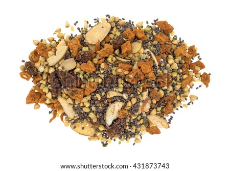Top view of a portion of dry breakfast cereal consisting of chia seeds, nuts, and dried fruit isolated on a white background. - stock photo