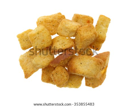 Top view of a portion of large seasoned croutons isolated on a white background. - stock photo