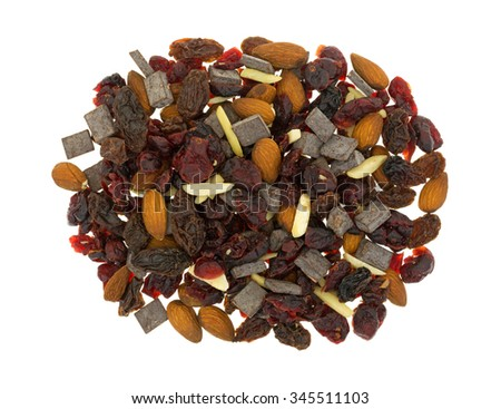 Top view of a serving of trail mix consisting of dried cranberries, sliced almonds, raisins and chunks of chocolate isolated on a white background. - stock photo