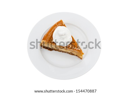 Top view of a slice of pumpkin cheesecake with whipped cream on top - stock photo