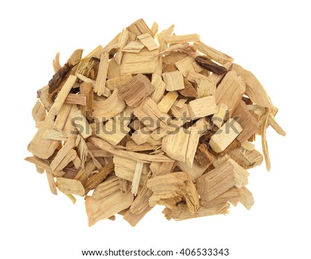 Top view of a small pile of hickory wood smoking chips for flavoring barbecue and grilled foods isolated on a white background. - stock photo