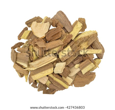 Top view of a small pile of mesquite wood smoking chips for flavoring barbecue and grilled foods isolated on a white background. - stock photo