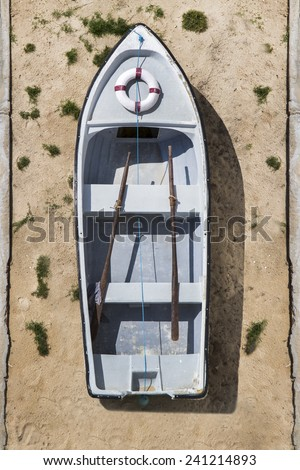 Top view of a small Portuguese traditional fishing boat  on the sand. - stock photo