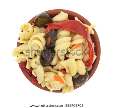 Top view of a small serving of rotini pasta salad in a small bowl isolated on a white background. - stock photo