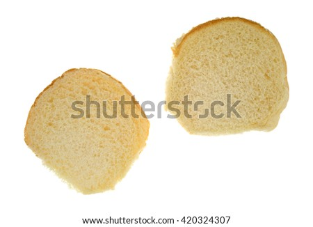 Top view of a white bread sesame seed hamburger bun open isolated on a white background. - stock photo