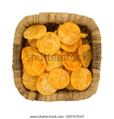 Top view of a wicker basket filled with barbecue flavored potato chips on a white background. - stock photo
