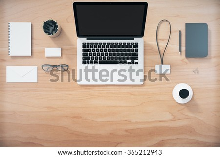 Top view of a wooden desk with a laptop and accessories 3D Render - stock photo