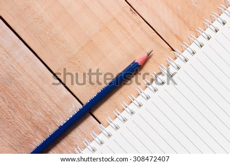 Top view of abstract background Notebook, Pencil, Wooden  - stock photo