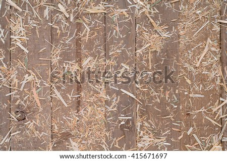Top View of Aged, Rough texture Rustic dull Brown Cedar Wood Boards with hay scattered for Backgrounds with Blank Room or Space for your Design, Words, Text or Copy.  Horizontal warm tones - stock photo