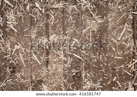 Top View of Aged, Rough textured Rustic dark Brown Cedar Wood Boards with hay scattered for Backgrounds and Templates with Blank Room or Space for your Design, Words, Text or Copy. Horizontal  - stock photo