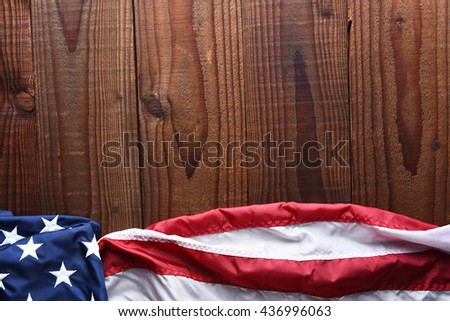 Top view of an American flag on a dark wood table with copy space. Horizontal format. - stock photo
