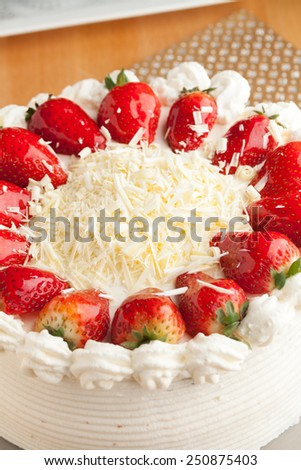 Top view of an entire strawberry shortcake with white chocolate shavings. - stock photo