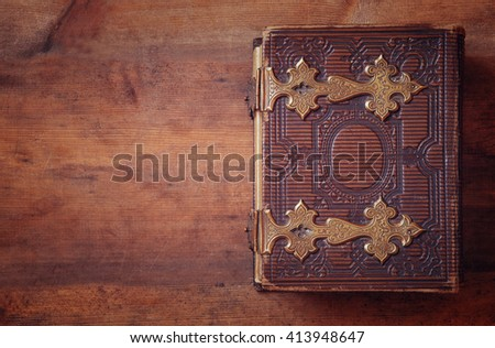 top view of antique book cover, with brass clasps. vintage filtered and toned