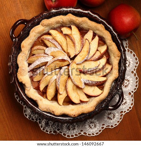 Top view of apple pie in cake tin - stock photo