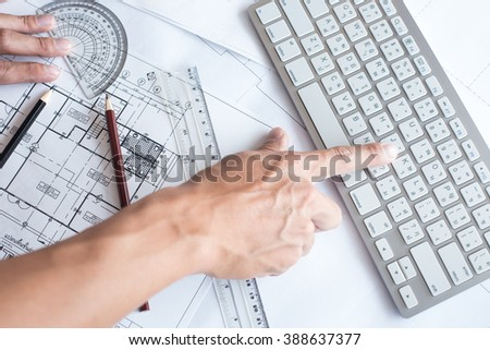 Top view of architect drawing on architectural project,Projecting with pencil on the urban drawings. home planning,Architectural plans - stock photo