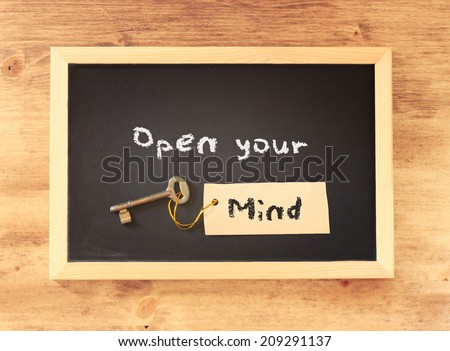 top view of blackboard with the phrase open your mind written on it. - stock photo