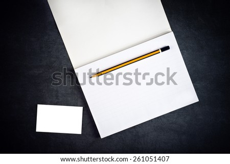 Top View of Blank Corporate Business Card and Notebook with Graphite Pencil as Copy Space for Branding - stock photo