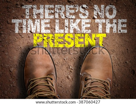 Top View of Boot on the trail with the text: Theres No Time Like the Present - stock photo