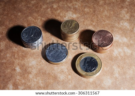 Top view of brazillian coins, real and cents. Business and money saving concept. - stock photo
