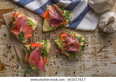 Top view of bruschetti on wooden table - stock photo