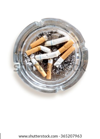 top view of burned cigarette in ashtray on white background - stock photo