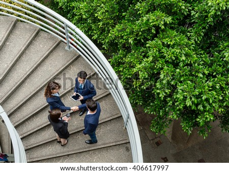 Top view of business people hand shaking - stock photo