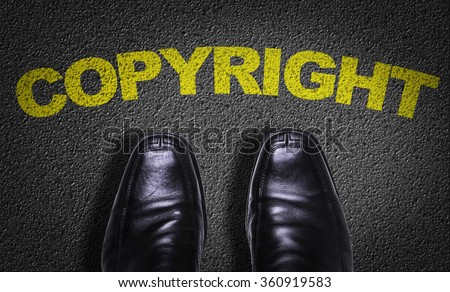 Top View of Business Shoes on the floor with the text: Copyright - stock photo
