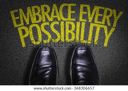 Top View of Business Shoes on the floor with the text: Embrace Every Possibility - stock photo