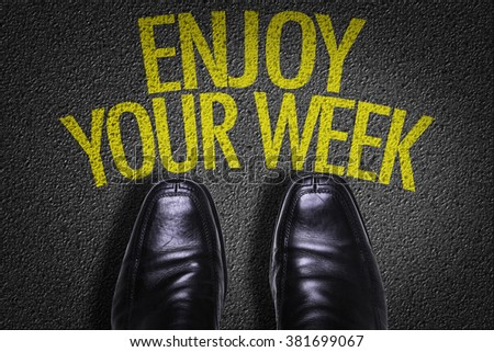 Top View of Business Shoes on the floor with the text: Enjoy Your Week - stock photo