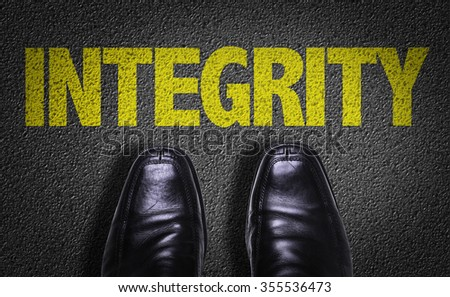 Top View of Business Shoes on the floor with the text: Integrity - stock photo