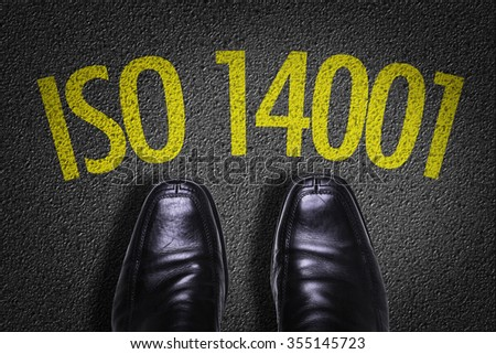 Top View of Business Shoes on the floor with the text: ISO 14001 - stock photo
