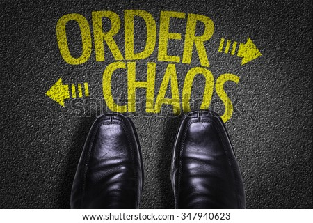 Top View of Business Shoes on the floor with the text: Order - Chaos - stock photo
