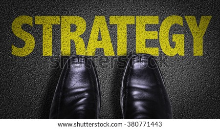 Top View of Business Shoes on the floor with the text: Strategy - stock photo