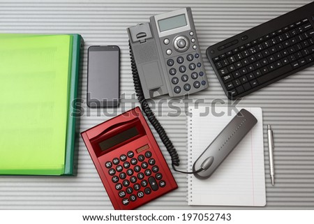 top view  of busy consultant desktop - stock photo