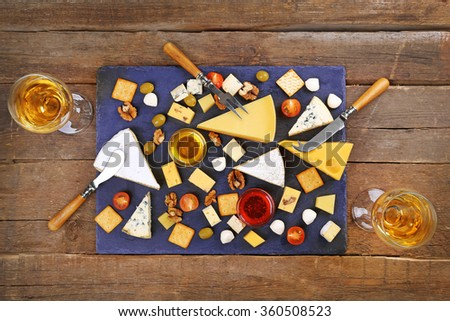 Top view of cheese for tasting on wooden table - stock photo