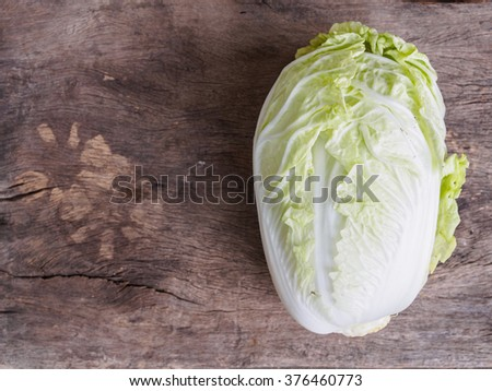 Top view of chinese cabbage vegatable on rustic wooden background white copy space - stock photo