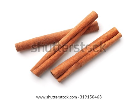 Top view of cinnamon sticks isolated on white - stock photo