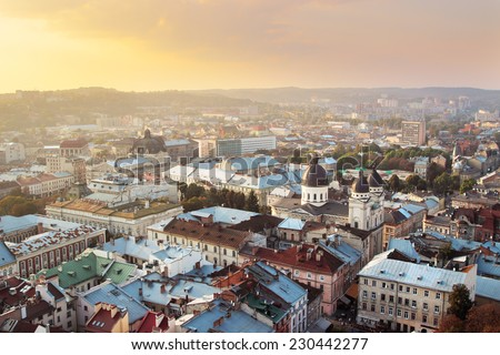 Top view of city filled with gold sunset light, Lviv, Ukraine - stock photo